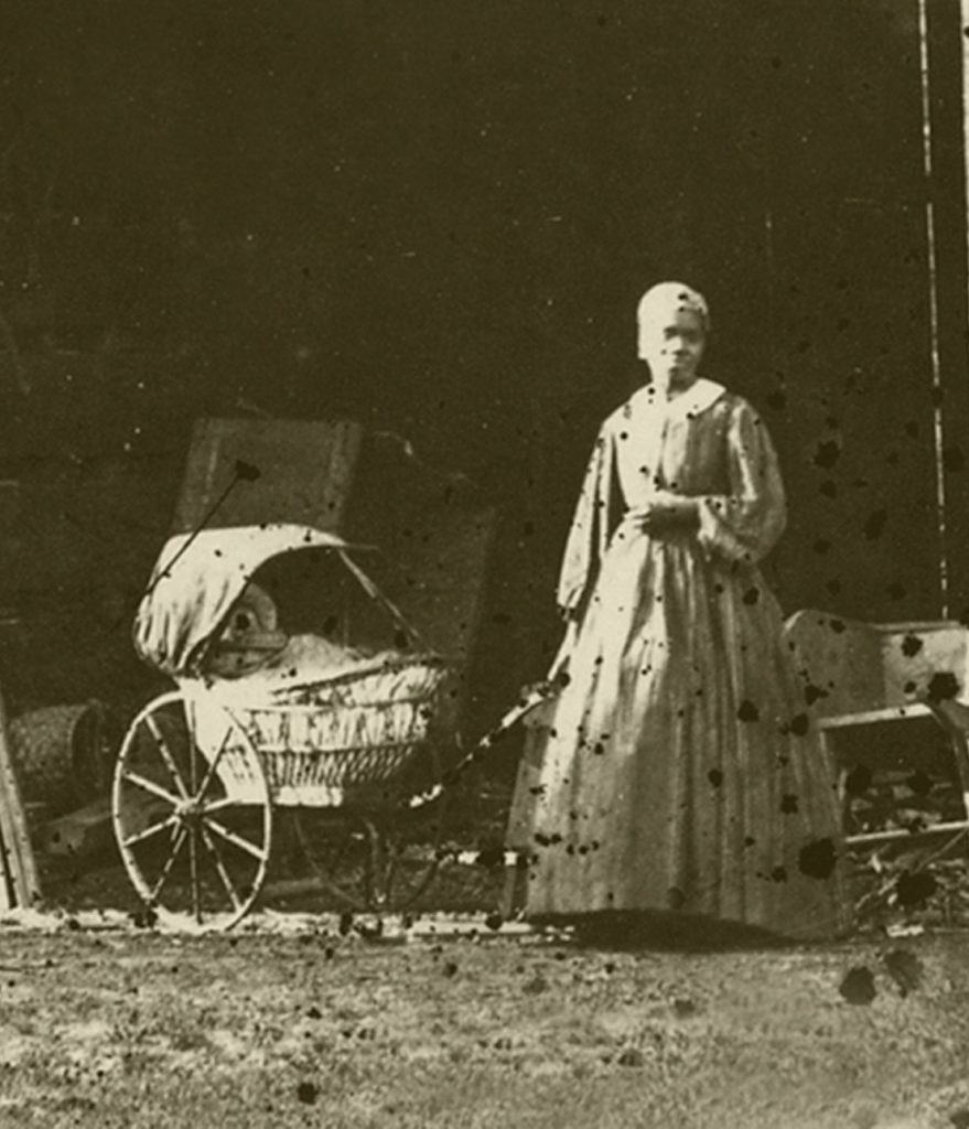 Detail of an (assumed) domestic servant from The University of Mississippi Carriage House collodion glass plate negative by Edward C. Boynton, a professor of chemistry, minerology, and geology from 1856–1861. Courtesy of the University of Mississippi Department of Archives and Special Collections.